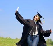 donna felice di graduazione Fotografia Stock