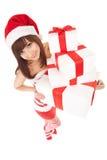 Donna felice di Santa con i contenitori di regalo Fotografie Stock