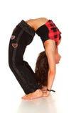 Donna flessibile che fa back-bend fotografia stock