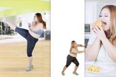 Donna grassa che spinge la sua cattiva abitudine fotografie stock libere da diritti