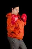 Donna grassa e guanti di inscatolamento rossi Fotografia Stock