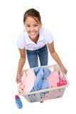 Donna graziosa che fa lavanderia Immagine Stock
