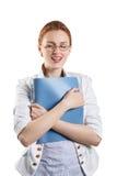 Donna graziosa che tiene una cartella Fotografie Stock Libere da Diritti