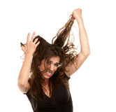 Donna graziosa con capelli selvaggi immagini stock