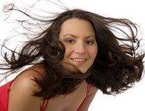 Donna graziosa con grandi capelli Fotografia Stock