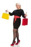 Donna graziosa con i sacchetti della spesa Immagini Stock Libere da Diritti