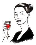 Donna graziosa con un bicchiere di vino Immagini Stock Libere da Diritti