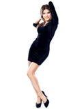 Donna graziosa in vestito nero Fotografia Stock Libera da Diritti