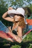 Donna in hammock Fotografia Stock
