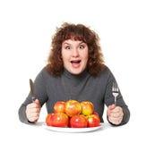 Donna impressionabile con le mele immagine stock