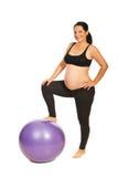 Donna incinta allegra con la sfera Immagine Stock Libera da Diritti