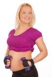 Donna incinta che fa le esercitazioni di forma fisica Fotografie Stock Libere da Diritti