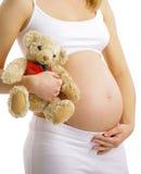 donna incinta che tocca la sua pancia con le mani fotografie stock libere da diritti