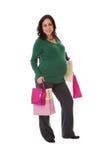 Donna incinta con i sacchetti di acquisto fotografia stock