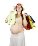 Donna incinta con i sacchetti di acquisto Fotografie Stock