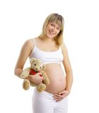 Donna incinta con il giocattolo fotografia stock