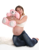 Donna incinta con un giocattolo Immagine Stock