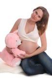 Donna incinta con un giocattolo fotografia stock libera da diritti