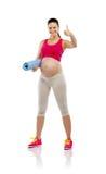 Donna incinta di forma fisica isolata su bianco Fotografia Stock
