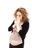 Donna incinta di starnuto Immagine Stock