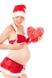 Donna incinta sexy come Babbo Natale fotografia stock