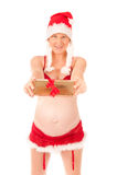 Donna incinta sexy come Babbo Natale Fotografia Stock Libera da Diritti