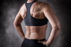 Donna invecchiata mezzo posteriore formata fotografie stock libere da diritti