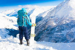 Donna, inverno dello snowboard, parte posteriore, zaino Immagini Stock