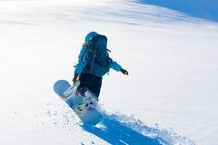 Donna, inverno dello snowboard, parte posteriore, zaino Fotografie Stock