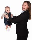 Donna lavoratrice con il bambino Fotografia Stock Libera da Diritti