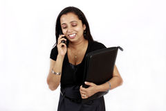 Donna lavoratrice sul telefono Fotografia Stock