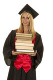 Donna in libro nero della tenuta dell'abito di graduazione Immagini Stock Libere da Diritti