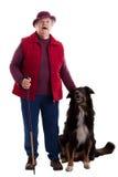 Donna maggiore attiva con il bastone da passeggio ed il cane 2 Fotografia Stock Libera da Diritti