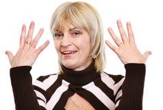 Donna maggiore che mostra le mani Immagini Stock Libere da Diritti
