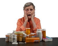 Donna maggiore con i farmaci fotografia stock