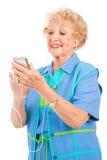 Donna maggiore con il giocatore multimedio Immagini Stock Libere da Diritti