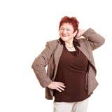 Donna maggiore di peso eccessivo sorridente fotografia stock libera da diritti