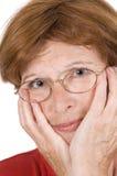 Donna maggiore preoccupata Fotografie Stock
