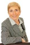 Donna maggiore sorridente di affari Immagini Stock