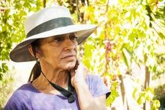 Donna matura con il cappello Immagini Stock Libere da Diritti