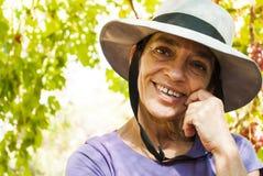 Donna matura con il cappello Fotografia Stock