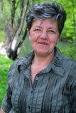 Donna matura felice esterna Fotografia Stock Libera da Diritti