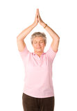 Donna matura nella posizione di yoga Immagini Stock
