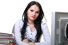 Donna moderna di affari che si siede alla scrivania fotografia stock libera da diritti