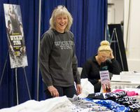 Donna Monte. Laughing while manning the Wicked Tuna booth Stock Photo