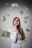 Donna nel bianco e nei dollari Immagine Stock Libera da Diritti