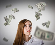 Donna nel bianco e nei dollari Immagini Stock