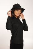 Donna nel cappello nero Fotografia Stock Libera da Diritti