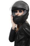 Donna nel casco del motociclista immagine stock