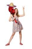 Donna nel concetto musicale con la chitarra su bianco Fotografia Stock